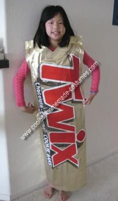 Homemade No-Sew Twix Costume: Materials: ·	Enlarged picture of the classic Twix bar (or actual Twix bar) ·	1 yd of shimmering gold cloth ·	2 ft of ironable fusible strips ·	1 roll of