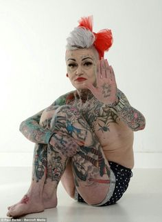 Mother who covered of her body with tattoos after splitting from her husband can't find a new man because her appearance scares them off Talk To The Hand, Wearing Purple, Weird Pictures, Get A Tattoo, Body Mods, New Man, Dress Outfits, Dresses, Body Art Tattoos