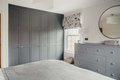 Contemporary master bedroom with bespoke fitted Wardrobes painted Paris Rooftops (grey)