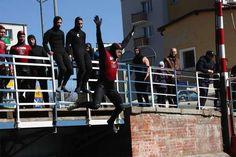 Śmigus-Dyngus 2012 w Kanale Łuczańskim. Note the wet suits...and coats on spectators.