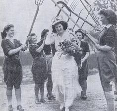 Another Land Girl wedding (complete with farm implement archway ;-).