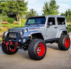SILVER 2 DOOR JEEP RUBICON - THE DETAIL IS UNIQUE! IT LOOKS GREAT WITH THE 4 IN LIFT RED WHEELS CUSTOMIZED, MODIFIED & INDIVIDUALIZED!!!!