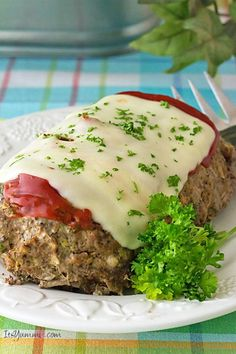 Slow Cooker Low Carb Meatloaf Recipe ~ Uses zucchini instead of bread crumbs  but tastes just like the comfort food you grew up eating!