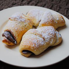 nutella on crescent rolls. dust with sugar