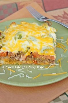 'John Wayne Casserole'. Source: Adapted from Mississippi Magazine. Ingredients: 2 pounds ground beef, cooked and drained 1 (1.25-ounce) packet taco seasoning 4 ounces sour cream 4 ounces mayonnaise 8 ounces Cheddar cheese, shredded and divided 1 yellow onion, chopped 2 cups Bisquick 1 cup of water 2 tomatoes, sliced 1 green bell pepper, chopped 1 (4-ounce) can sliced jalapeno peppers