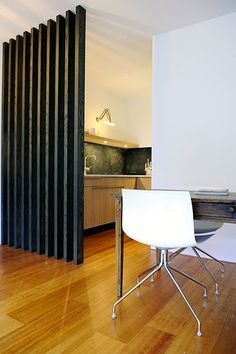 desire to inspire - desiretoinspire.net - Clijsters Architectuur Studio. love that chair, and the simple stained 2x4 room divider