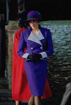Princess Diana, in one of favorite suits ever. That purple is so gorgeous on her..& it may help that it's my fav. color :)
