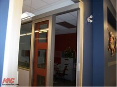 22. Mixing interior glass with Crowdertrack creates a feeling of openness in the office.
