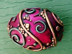 I created this piece by covering a hollow chicken egg with polymer clay. I added the swirls and pebbly bits, cured the piece to harden the clay and pain. Polymer Clay Kunst, Polymer Clay Dragon, Fimo Clay, Polymer Clay Projects, Clay Beads, Polymer Clay Jewelry, Egg Crafts, Easter Crafts, Biscuit