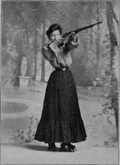 tough lady... wearing roller skates and shooting a gun in that skirt!