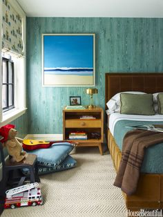 Nobilis's faux wood grain wallpaper adds a touch of woodland whimsy in the son's room.