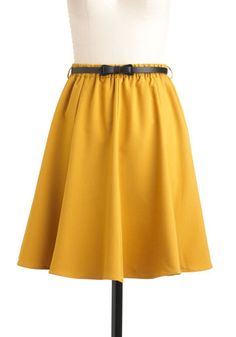 mustard skirt with skinny bow belt.  Adorable!