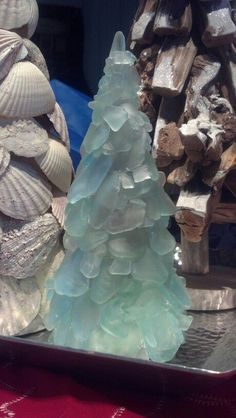 Sea glass, scallop shell Christmas tree  -use a cardboard cone and hot glue gun!
