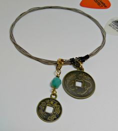 Guitar String Bangle Bracelet with Asian Coin Replicas and Aqua Bead Charms - RECYCLED! - pinned by pin4etsy.com