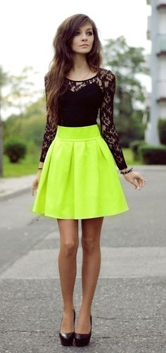 Black long sleeve lace shirt with bright neon yellow skirt