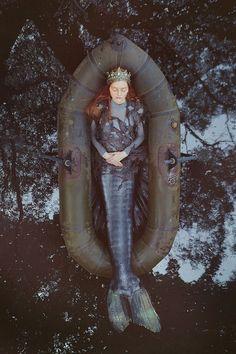 mermaid in raft