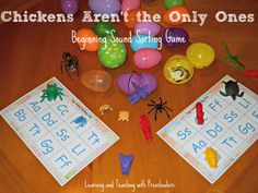 Beginning Sound game using plastic eggs with plastic animals and insects that lay eggs.  Such fun for little ones.