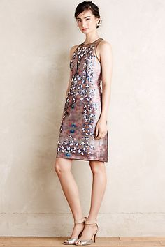 Jaw dropping cocktail dress with a sheer back and 3d detailing! Twining Vine Sheath - anthropologie.com #anthroregistry $995