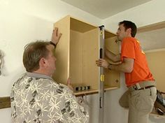 Install cabinets yourself and save. Paint cabinets.  How to's at DIY  http://www.diynetwork.com/topics/kitchen-cabinets/index.html