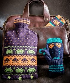 Free Knitting Pattern for Space Invaders Set - Hot Water Bottle Cover, Phone Cozy and Fingerless Mitts with Space Invaders characters in stranded colorwork. Designed by Lynne Rowe