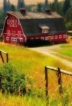 love the old red barn look.. need to own land asaps.. oh and win the lottery cause i will need a big indoor and multiple trucks ;)