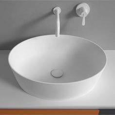 AGAPE ON TOP WASHBASIN in glossy or mat white Ceramilux®, a modern and resistant composite material, the 661 washbasin for resting on a top has an oval shape and deep basin, with a high and slim edge. Dimensions cm x x - x x Benedini Associati Toilet Vanity, Boffi, Stone Sink, Bathroom Basin, Plumbing Fixtures, House Goals, Beautiful Bathrooms, Master Bath, Countertops