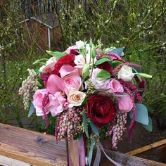 Pink, marsala and blush spring bridal bouquet.  Lush and full with amazing texture!  Romantic wedding in the woods in Ariel, WA.  Such a beautiful location! www.staceysflowerspdx.com