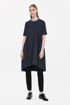 This high-neck dress has a voluminous skirt with dart seams that create a folded cocoon shape. Fitted across the shoulders, it has short sleeves, a hidden back zip and a graduated hemline. Wardrobe Sale, Small Wardrobe, Cocoon Dress, Hemline, Short Sleeves, Normcore, High Neck Dress, Tunic Tops, Style Inspiration
