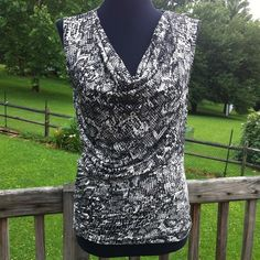 Nine West Snake Print tank This Nine West top is brand new with tags. A super soft material and a flattering draped neckline. Gorgeous snake print pattern. Nine West Tops Tank Tops