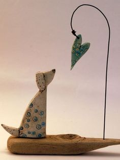 Shirley Vauvelle Mixed Media Artist fish on hook or wire waves over boat instead of dog
