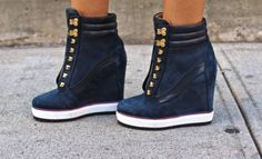 Michelle Salas is wearing boots from our exclusive Hilfiger Collection.