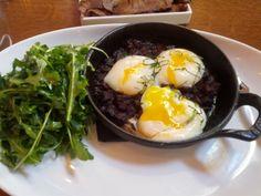 Awarma Eggs - Lamb confit, three poached eggs, arugula salad served in Staub at Ilili Restaurant, New York, NY