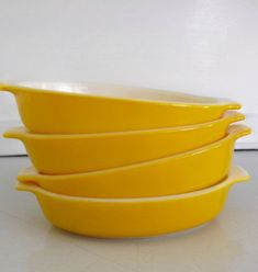 Set of 4 yellow Pyrex individual casseroles or gratin by oodles $21.75