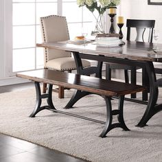 This stylish dining bench is an excellent way to update your dining room. The base of the bench has a Victorian style trestle, giving a reclaimed, industrial appearance. The seat furthers this look with rustic finish. Pair with the matching dining room table and upholstered Parson chairs for a mixed, but cohesive dining configuration.