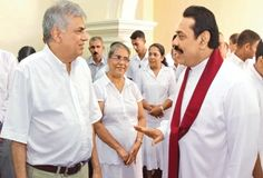 The seventh day alms giving of Sam Wijesinha, a former Secretary General of Parliament, took place at his residence in Mount Lavinia yesterday. President Mahinda Rajapaksa and Opposition Leader Ranil Wickremesinghe were among those present. The President also offered alms to the Maha Sanga. Here President Rajapaksa in conversation with the Opposition Leader with members of the Wijesinha family in the background. Picture by Nishanka de Silva