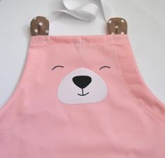 Apron for children aged It's made of very thick cotton (like denim). It works perfectly for the kitchen (for little cooks) and kindergarten (for little artists). It's decorated with a patch and has an easily ajustable strap. Preschool Backpack, Toddler Backpack, Little Backpacks, Cute Backpacks, Childrens Purses, Kindergarten Photos, Baby Clothes Patterns, Sewing Aprons, Apron Designs