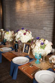 glittery reception, photo by Blue Rose Photography http://ruffledblog.com/seattle-new-years-eve-wedding #weddingideas #centerpieces