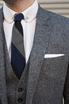 Gorgeous heather grey wool 3 piece suit paired with a narrow stripped tie & white button up