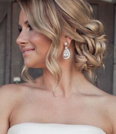 A gorgeous, loosely curled wedding updo with hair wrapped into a low, messy bun. Discover how Vênsette can craft custom beauty looks for your special moment: http://vensette.com/bridal_inquiries