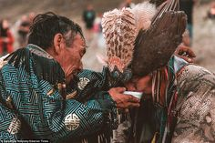 In one of the more intimate rituals, one of the shamans places his hand around his counter...