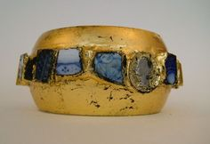 The Bangle is made with blue china fragments from Hampstead Heath and old coin. Alexandra Abraham