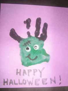 A fun Halloween hand print art project from a KinderCare toddler.