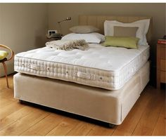 Vispring Elite Mattress Vi-Spring's entry-level mattress surpasses the best offerings from most other bed manufacturers. A deep filling of British fleece wool and cotton overlays Vi-Spring's unique six-coil pocket springs, for unqualified comfort.