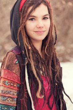 Love her dreads and jacket and eyebrow piercing.
