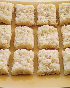COCONUT BARS -  Vegetable-oil cooking spray, 1 lb grated fresh coconut or unsweetened shredded coconut, 2 3/4 C sugar, 1 can (14 oz) sweetened condensed milk, 1 can (12 oz) evaporated milk {shape into 12x13 rectangle}