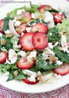 Dressing:   1/4 cup honey   2 tablespoons white wine vinegar   1 teaspoon dijon mustard   1/4 cup extra-virgin olive oil   coarse salt and fresh black pepper   Salad:   2 packed cups baby spinach   2 packed cups chopped romaine hearts   1 heaping cup sliced strawberries   1 cup chopped or shredded cooked chicken   1/3 cup crumbled feta cheese   1/4 cup chopped walnuts