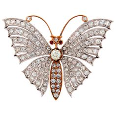 Victorian Diamond Ruby  Gold Butterfly Brooch | From a unique collection of vintage brooches at https://www.1stdibs.com/jewelry/brooches/brooches/