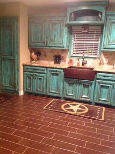 Rustic turquoise kitchen...love the cabinets!