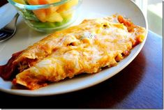 Vegetarian Enchiladas are cheesy, delicious, and filling. Nobody will miss the meat! | iowagirleats.com