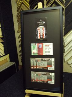 Collection of football tickets in a simple black frame